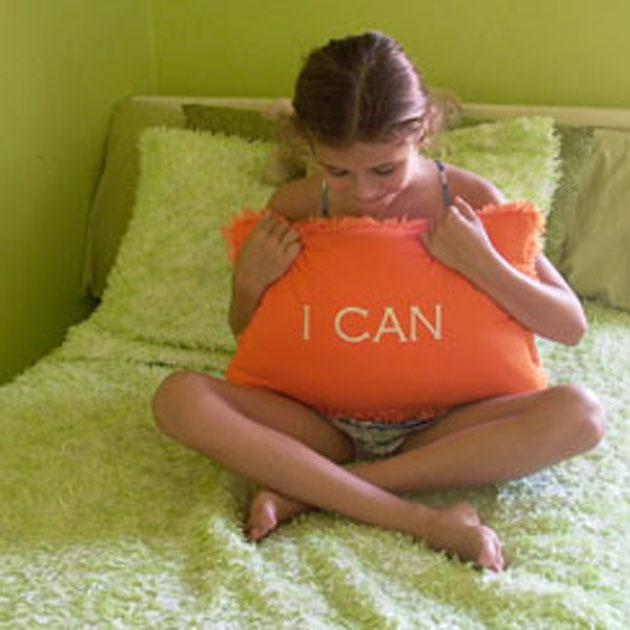 A photo of a little girl holding a Inspirational pillow